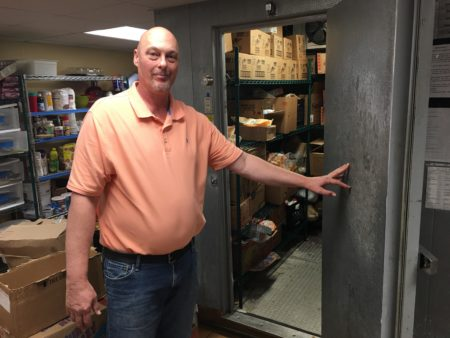 Russell Weaver standing in kitchen at Overcomers Center