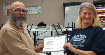 Karen Prescott receives Personal Development Program certificate