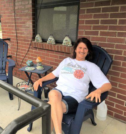 Karen Prescott sitting on porch