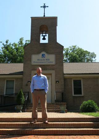 Ryan Duerk in front of Miracle Hill Ministries' Overcomers addiction recovery center in Greenville, SC