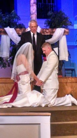 Wade and Jade Cason kneel at the altar to pray during their wedding, thanking God for setting them free from addiction.
