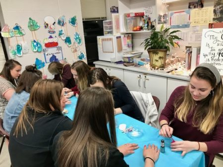 Volunteers paint nails at Party with a Purpose