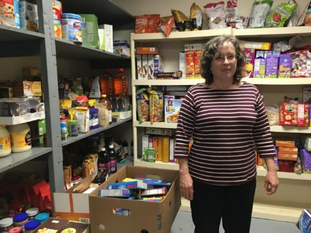Shepherd's Gate Kitchen Manager Carrie Seils works to ensure healthy choices are available in the shelter's pantry.