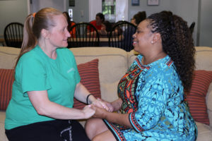 Venus Dixon (right), Director of Renewal, meeting with a woman in recovery